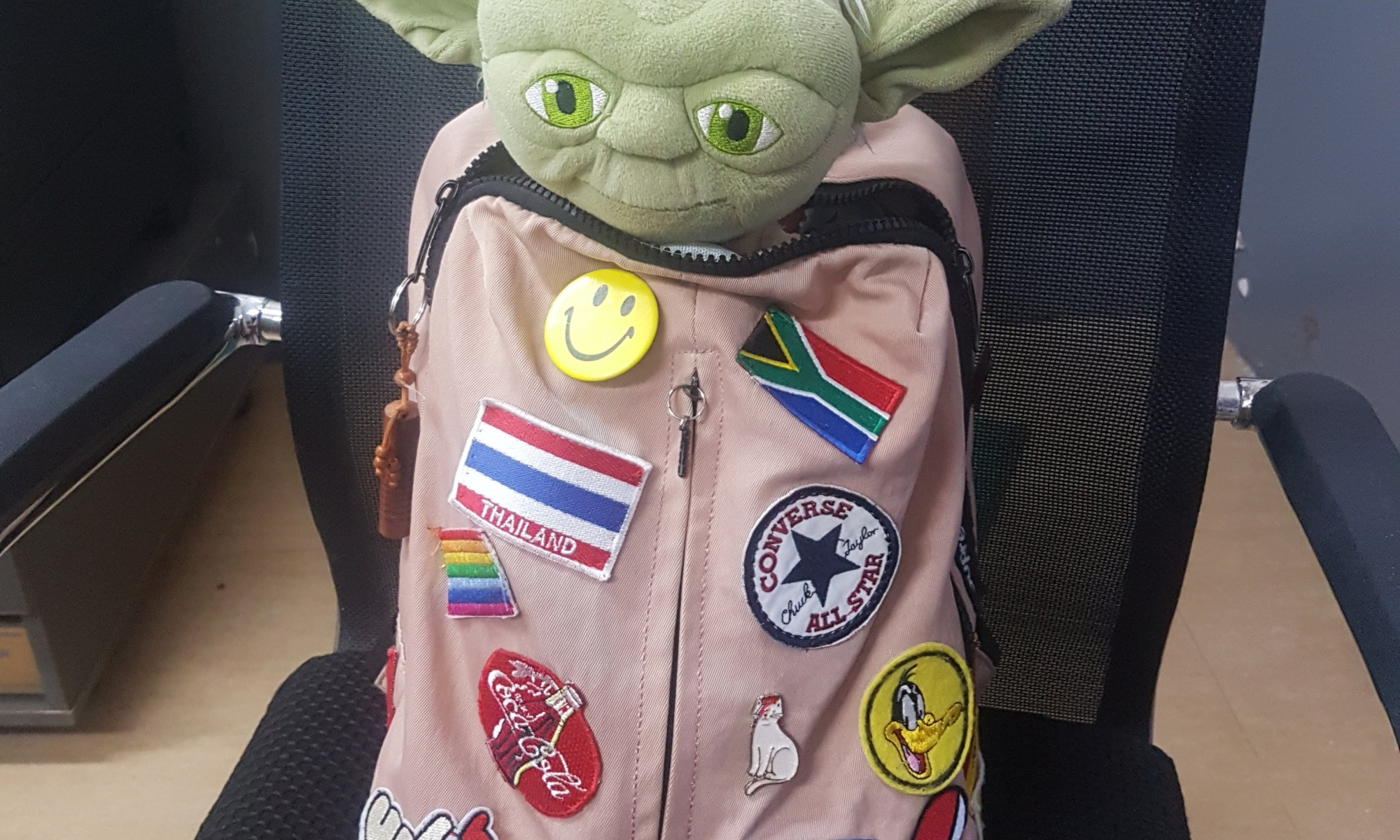 School bag with yoda doll inside