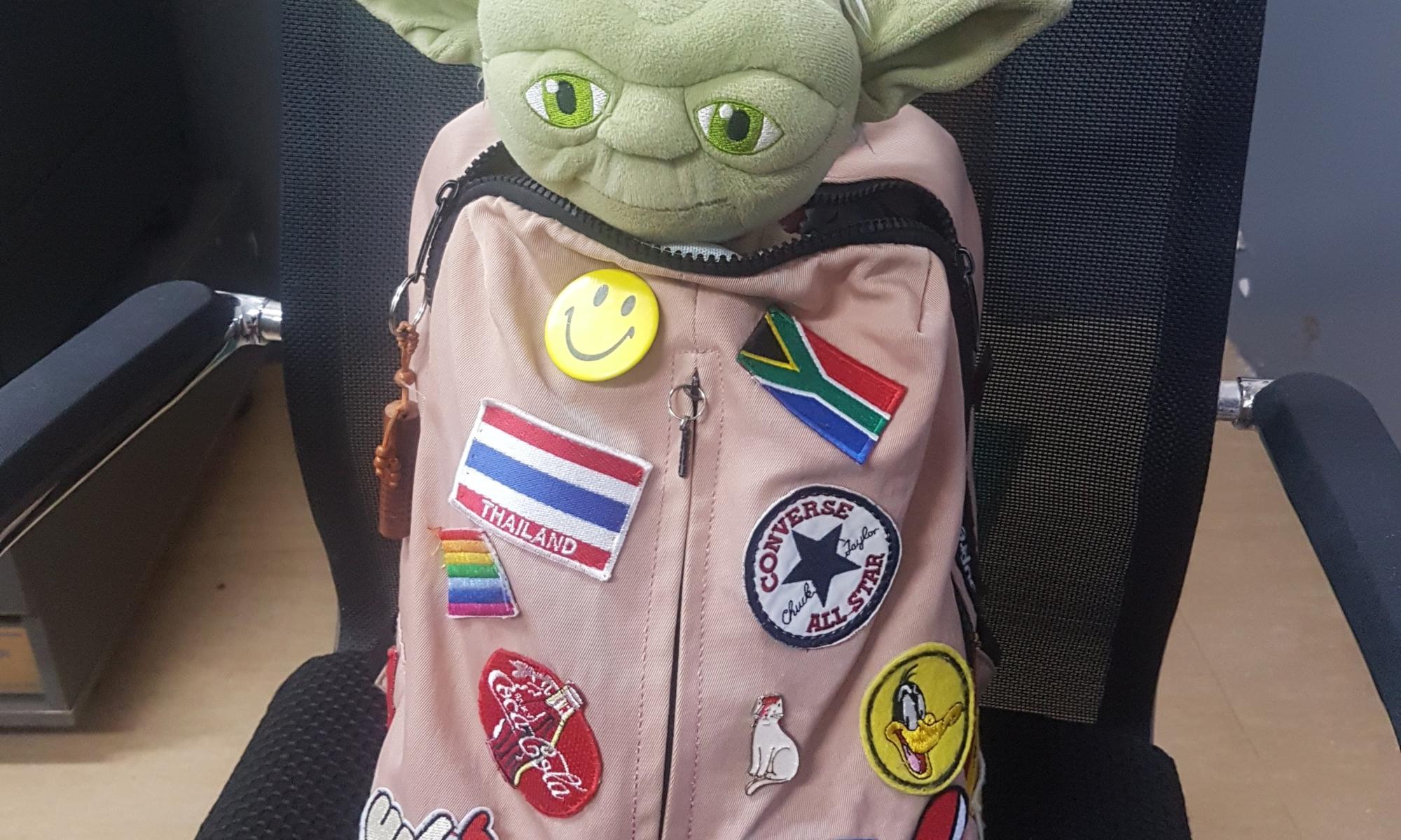 School bag with yoda doll inside