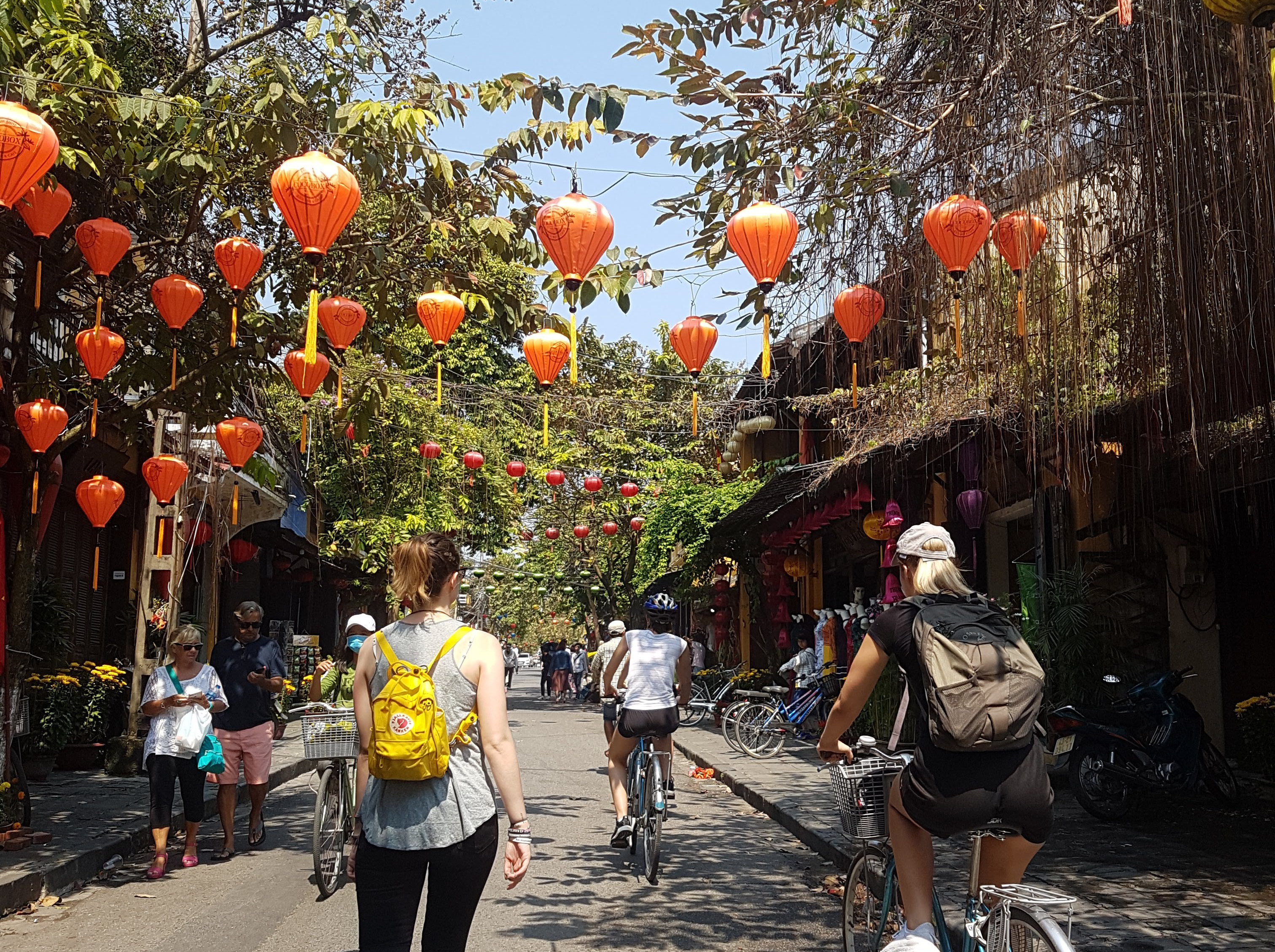 a busy colourful street in Hoi An